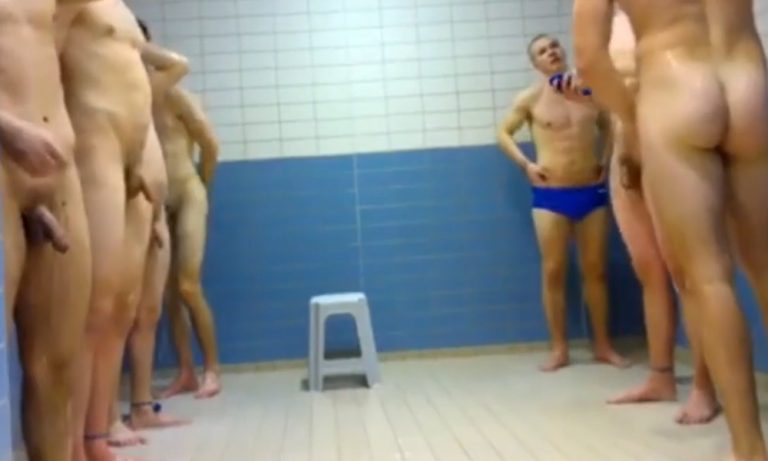 The seven studs on the swim team strip, shower, & sleep together while on the road for competition. Blue trunk signifies who is sub for the day.